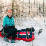 A woman in a wilderness during winter